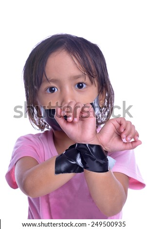 kid with taped mouth and hand, begging for help. Sad, abuse girl. Violence, despair. - stock photo