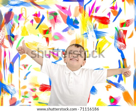 Kid with thumbs up against wall with colors on