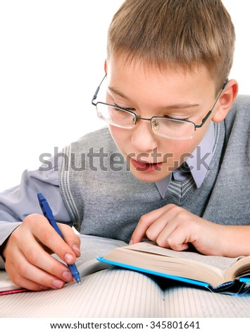 Kid writing at the School Desk on the White Background - stock photo