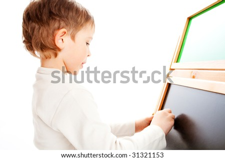 Kid writing something on a blackboard