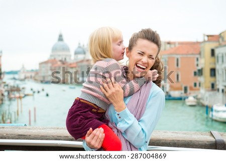 Kiddie whispers... Also known as tickle torture and giggle fits! - stock photo