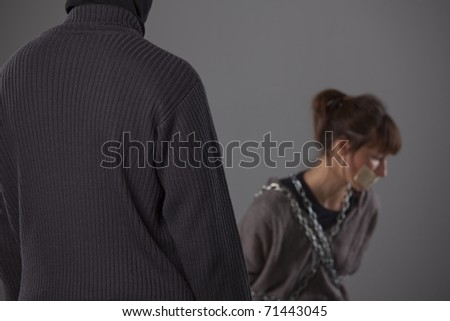kidnapped woman and killer - focus on male sweater - stock photo