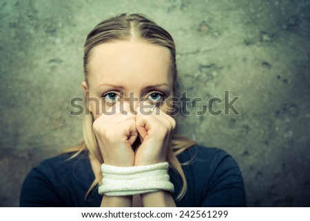Kidnapped woman - Young girl victim of abuse and domestic violence - stock photo
