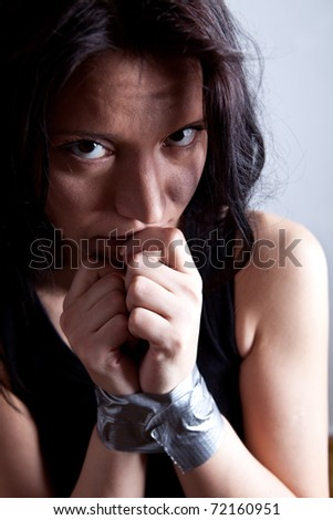 kidnapped young woman, hostage closeup - stock photo
