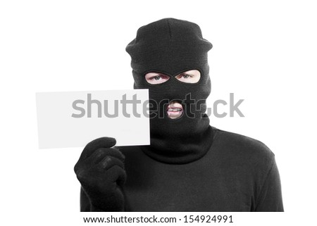 Kidnapper presenting his demands for payment in a ransom note to facilitate the release of a kidnapped person during an abduction or retrieval of stolen priceless or irreplaceable items - stock photo