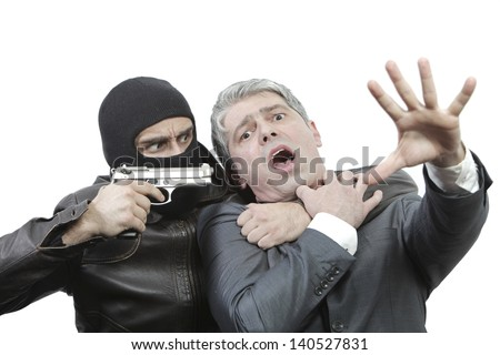 Kidnapper threating a businessman with a gun.../Businessman in danger - stock photo