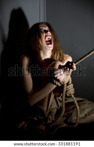 Kidnapping concept. Image of hostage screaming - stock photo