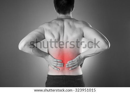 Kidney pain. Man with backache. Pain in the man's body. Black and white photo with red dot - stock photo