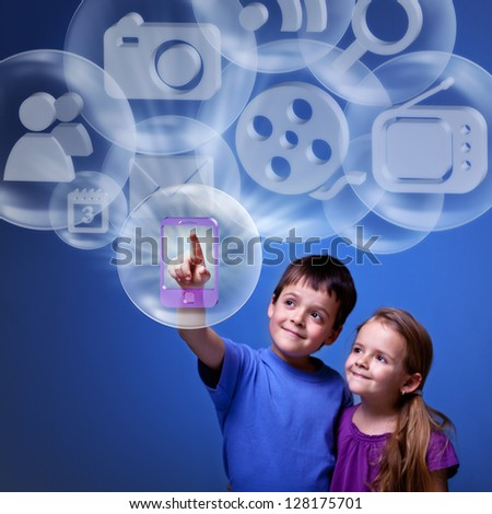 Kids accessing cloud computing applications for mobile device - stock photo
