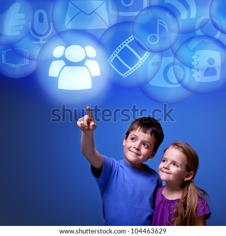 Kids accessing cloud computing applications from virtual space - futuristic - stock photo