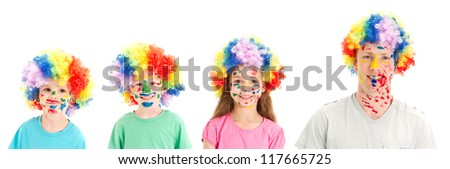 Kids and Dad with painted faces and clown wigs. Isolated on white. - stock photo