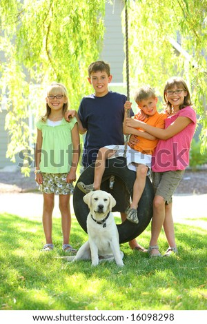 Kids and dog in yard - stock photo
