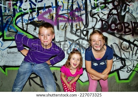 Kids and graffiti wall - stock photo