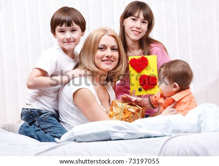 Kids and mom celebrating Mother's Day - stock photo