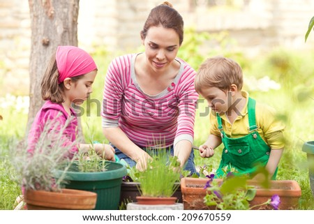 Kids and mother gardening - stock photo