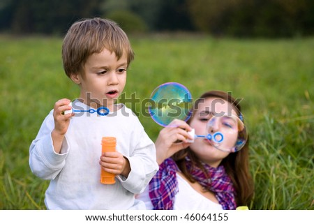 Kids are  blowing soap bubbles