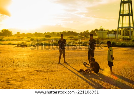 kids are playing soccer football for exercise in the evening. - stock photo