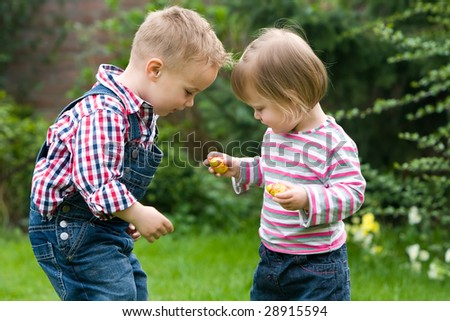 Kids are sharing candy with each other. - stock photo