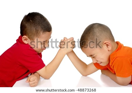 Kids arm-wrestling, ages eight and six, isolated on white background