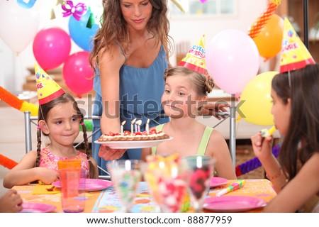Kids at birthday party - stock photo