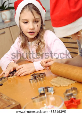 Kids baiking Christmas cookies in the kitchen - stock photo
