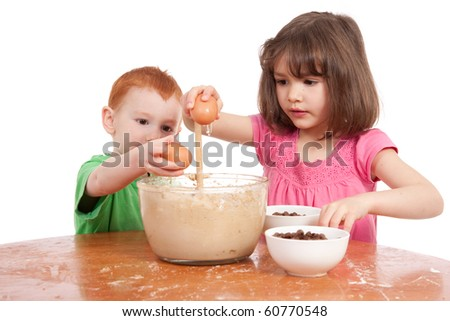 Kids baking chocolate chip cookies. Isolated on white. - stock photo