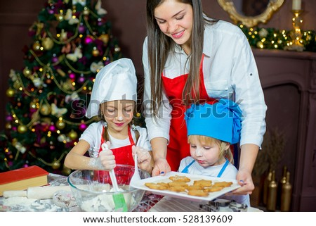 kids baking christmas cookies before the celebration of Christmas. Family