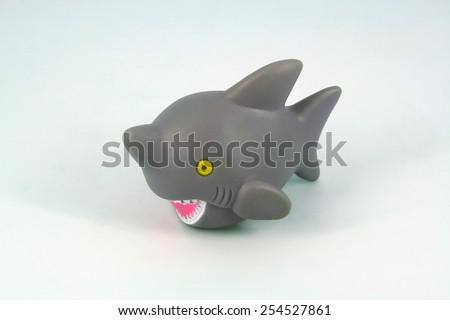 Kids bathing toy. Children bath toy. Shark toy. - stock photo