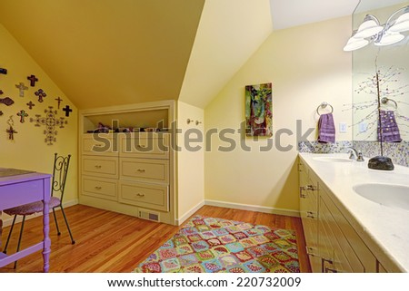 Kids bathroom interior with vaulted ceiling. Bathroom vanity cabinet with mirror., built-in cabinet with drawers and table
