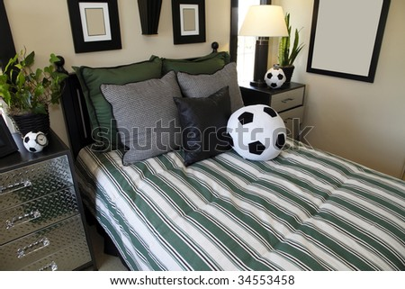 Kids bedroom with contemporary furniture and soccer decor.