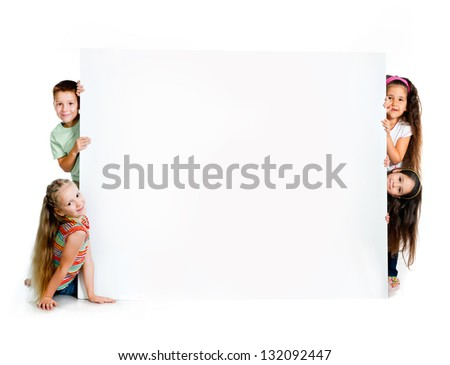 kids beside a white blank for text or image