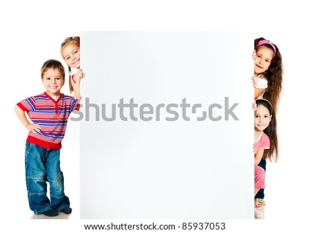 kids beside a white blank for text or image - stock photo