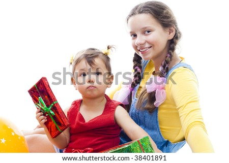 Kids birthday - toddler and teenager girls sit with gifts,isolated on white - stock photo