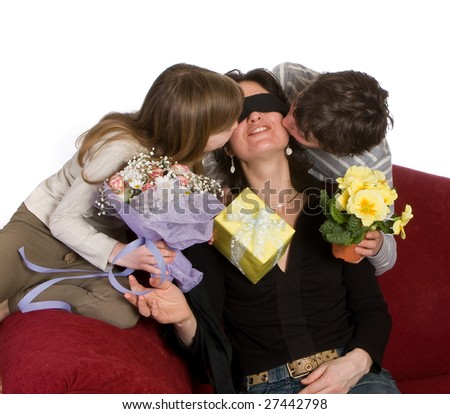 Kids blindfolding their mother on mother's day - stock photo