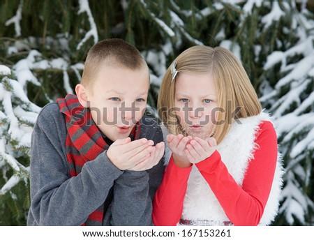 Kids Blowing Snow - stock photo