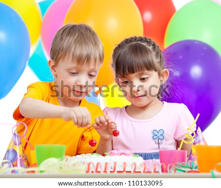 kids boy and girl eating cake on party birthday - stock photo