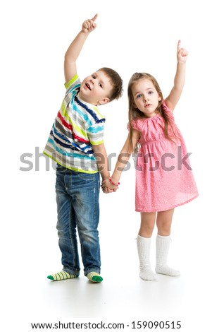 kids boy and girl showing something up - stock photo
