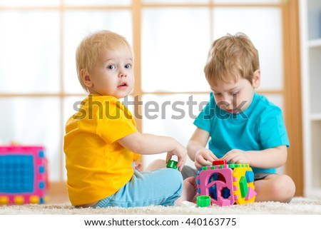 Kids boys playing in the nursery room - stock photo