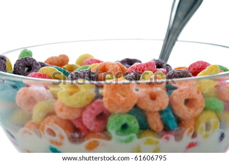 kids breakfast cereal loops with a spoon in fresh cows milk or could be almond milk or even soy milk. isolated on white - stock photo