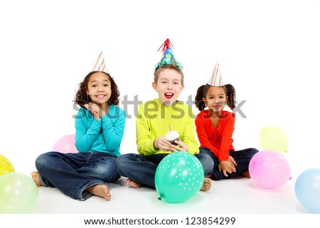 Kids celebrating a birthday - stock photo