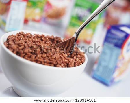 kids cereal bowl with various packs out of focus in background - stock photo
