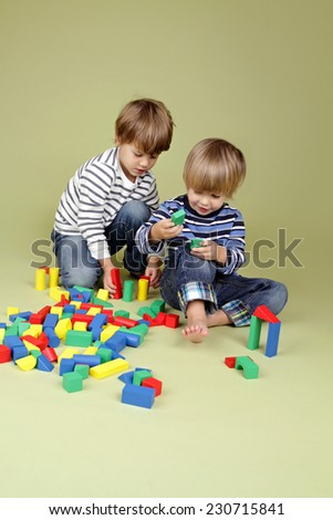 Kids, children, sharing, playing nicely together, teamwork and cooperation concept - stock photo