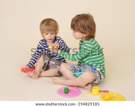 Kids, children sharing pretend food, cooking - stock photo