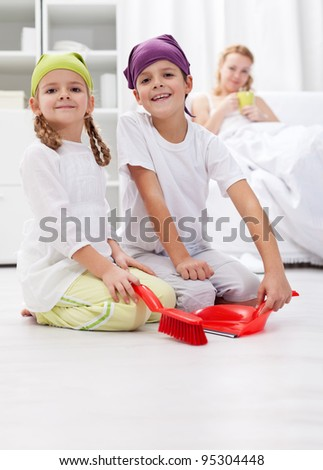 Kids cleaning the room helping  their sick  mother - stock photo