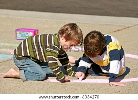 Kids Coloring with Chalk - stock photo