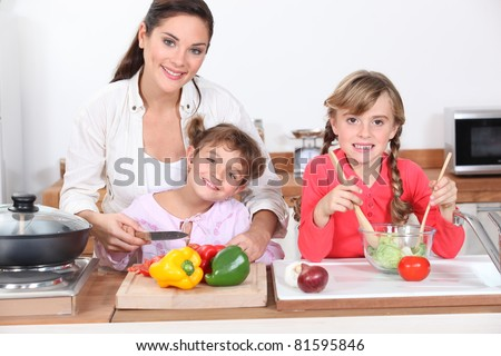 Kids cooking with their mother - stock photo