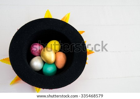 Kids crafts for Easter Eggs, Handmade of Color poster painted painting to decorate for the party put in a hat. - stock photo