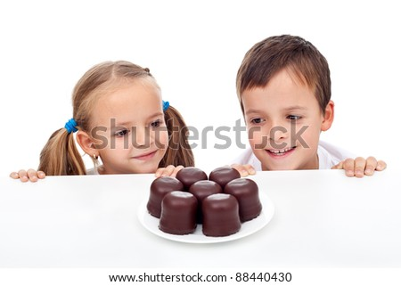 Kids craving sweets, happy to found some - stock photo