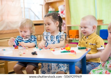 kids doing arts and crafts in day care centre
