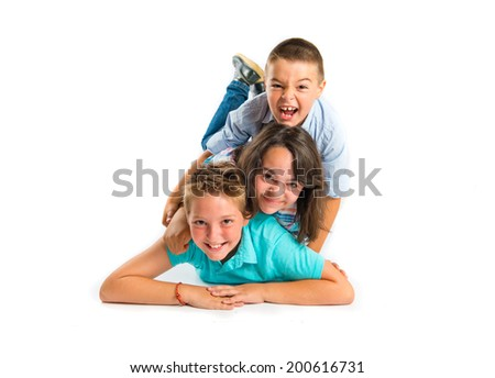 Kids doing the pyramid over white background